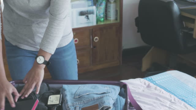 asian women packing clothes luggage - luggage stock videos & royalty-free footage