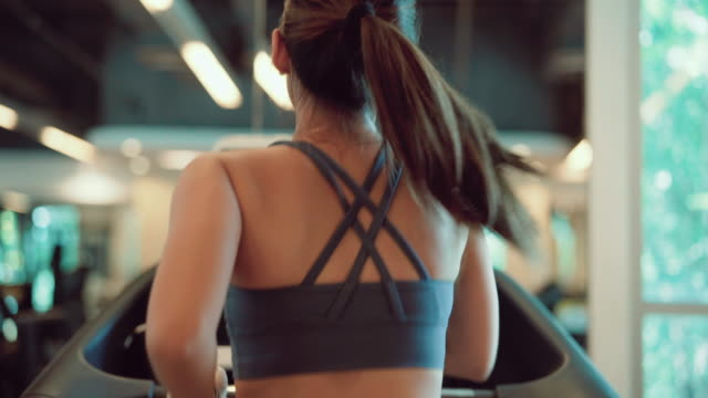 asian women running on treadmill in the sport gym. - cardiovascular exercise stock videos & royalty-free footage