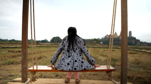 asian women sit and watch the view and use the phone to take pictures at the view point. - square composition stock videos & royalty-free footage
