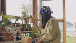 Asian women traveler enjoying in garden.