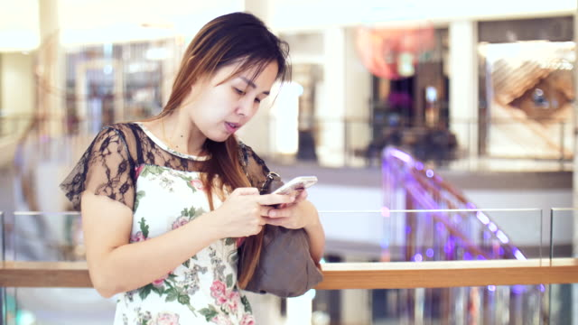 asian women using mobile phone - realisticfilm stock videos and b-roll footage