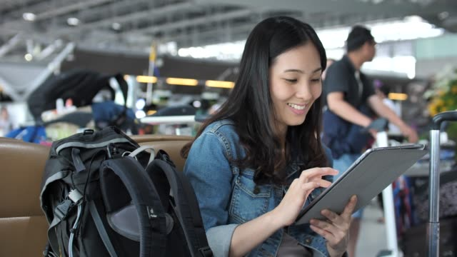 asian women using tablet at the airport - electronic book stock videos & royalty-free footage