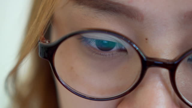 asian women watching screen, reflection in glasses - reading glasses stock videos & royalty-free footage