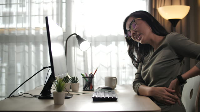 asian women with back pain sin an office syndrome and working hard - neck stock videos & royalty-free footage