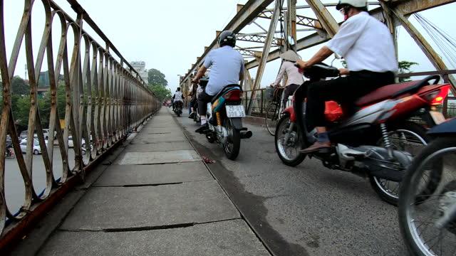 asian workers crossing the long bien bridge hanoi - bridge built structure stock videos & royalty-free footage
