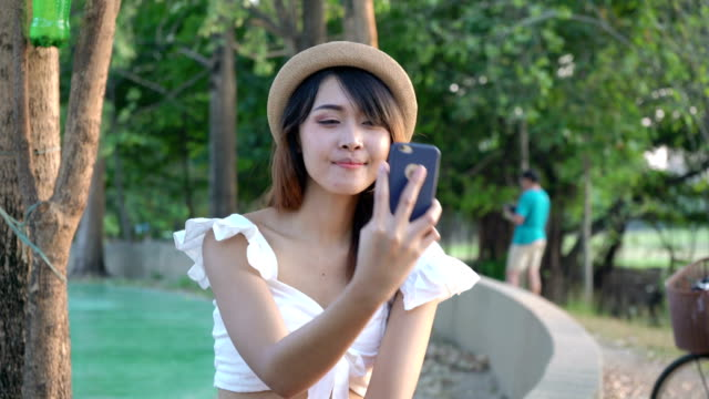 asian young business people are using smartphones take a picture of yourself - notifications stock videos & royalty-free footage
