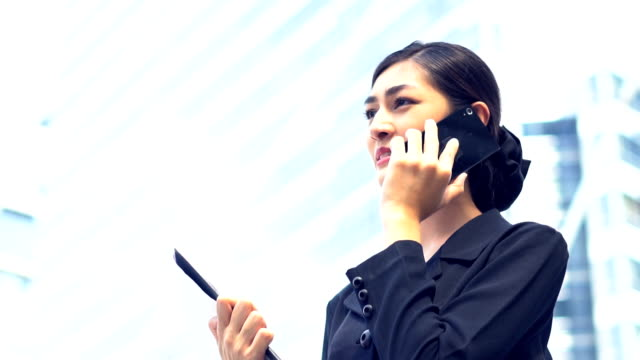 asian young business woman use smartphone in the center capital city - dialling stock videos & royalty-free footage