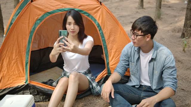 vídeos de stock e filmes b-roll de asian young couple enjoying camping in the pine forest - pine