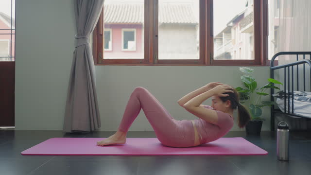asian young cute woman wearing sports training clothes understands the importance of core strength, exercising bodyweight training in her home, apartment as an instructor. - bodyweight training stock videos & royalty-free footage