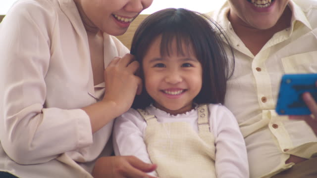 asian young family - hotel room stock videos & royalty-free footage