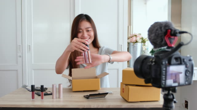 asian young female blogger recording vlog video with makeup cosmetic at home online influencer on social media concept.live streaming viral - for sale stock videos & royalty-free footage