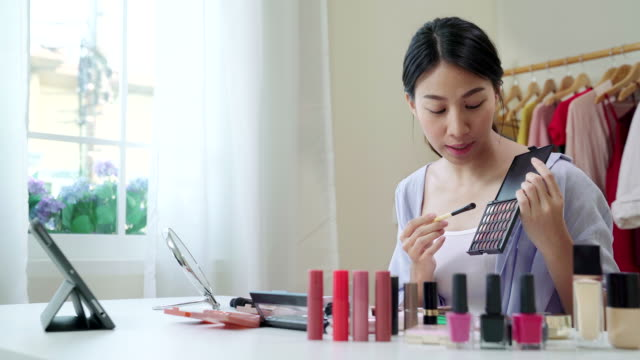 asian young female blogger recording vlog video with makeup cosmetic at home. influencer woman live streaming viral online. - marketing stock videos & royalty-free footage