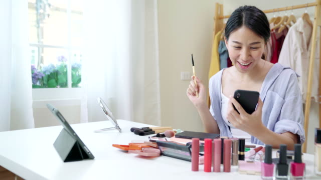 asian young female blogger recording vlog video with makeup cosmetic at home. influencer woman live streaming viral online. - tutorial stock videos and b-roll footage