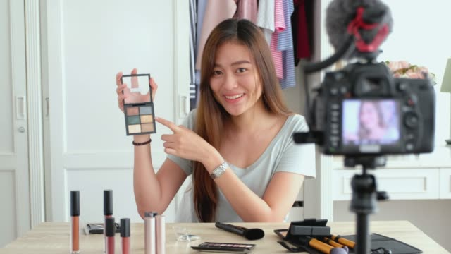 asian young female blogger recording vlog video with makeup cosmetic at home online influencer on social media concept.live streaming viral - tutorial stock videos and b-roll footage