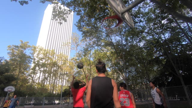 asian young men play basketball on a street court in the azca complex on october 9 2020 in madrid spain azca considered the business heart of the... - leisure facilities stock videos & royalty-free footage