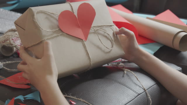 asian young teenager girl making handmade items care package. cute girl packing a girt box prepare to sending to her family or friends from distance. - wrapped stock videos & royalty-free footage