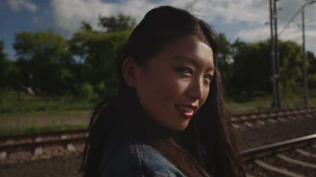 Asian young woman alone on the railway.