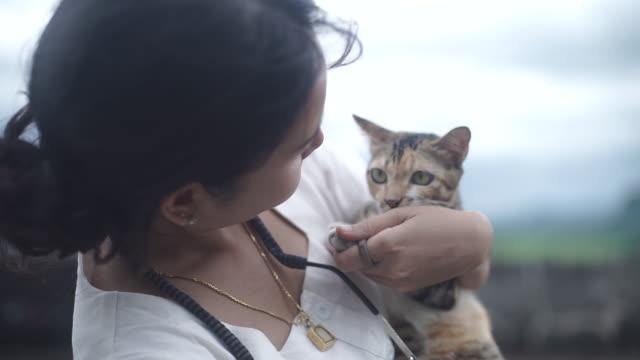 Asian Young woman hugging cat.