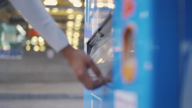 asian young woman picking up drink from vending machine - inserting stock videos & royalty-free footage