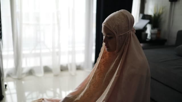 asian young woman sholat and reading qur'an - koran stock videos & royalty-free footage