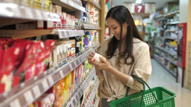 asian young woman shopping in supermarket - vitamin stock videos & royalty-free footage