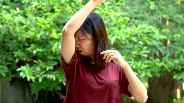 asian young woman smells her armpits - cruel stock videos & royalty-free footage