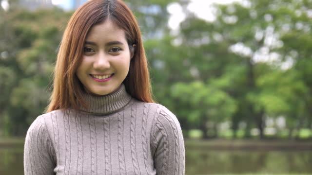 SLO MO Asian young Woman smiling at camera