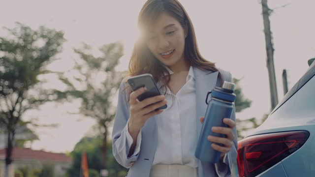 asian young woman using mobile phone - water bottle stock videos & royalty-free footage