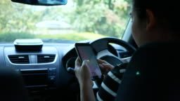 Asian young woman using the Google Maps application on a smartphone to search for directions while driving. Concept of using technology in transportation.