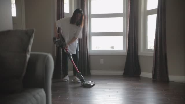 asian young woman using vacuum to cleaning room - vacuum cleaner stock videos & royalty-free footage