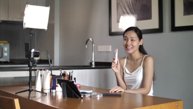 asian young woman youtube blogger recording vlog video with makeup cosmetic at home making online influencer on social media concept.live streaming viral - stream stock videos & royalty-free footage