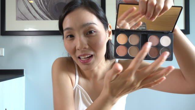 asian young woman youtube blogger recording vlog video with makeup cosmetic at home making online influencer on social media concept.live streaming viral - make up stock videos & royalty-free footage