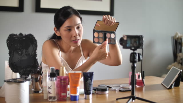 asian young woman youtube blogger recording vlog video with makeup cosmetic at home making online influencer on social media concept.live streaming viral - electrical equipment stock videos & royalty-free footage