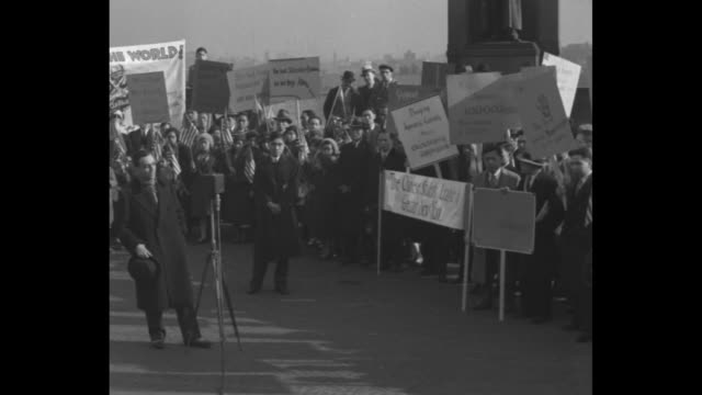 stockvideo's en b-roll-footage met asian-americans standing with banners and placards; pan across crowd as sot politician william loeb jr. on japanese occupation of manchuria / note:... - east asian ethnicity