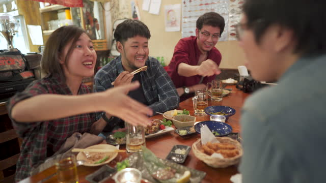 asians enjoying a conversation with friends at dining - catering building stock videos & royalty-free footage