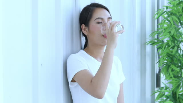 asianwoman and trainer work out in the fitness class and and drinking water - overweight yoga stock videos & royalty-free footage