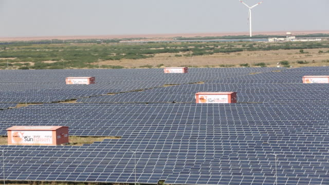asia's largest solar popwer station, the gujarat solar park, in gujarat, india. it has an installed capacity of 1000 mw - グジャラート州点の映像素材/bロール
