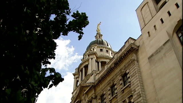 low angle views of golden lady justice statue on top of old bailey 'central criminal court' sign general view of old bailey - statue of justice london stock videos and b-roll footage