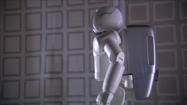 asimo, a humanoid robot, moves its arm. - asimo stock videos & royalty-free footage