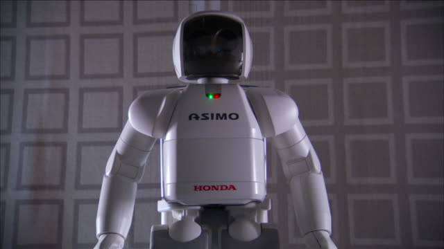 asimo, a humanoid robot, turns its body to face a different direction. - asimo stock videos & royalty-free footage