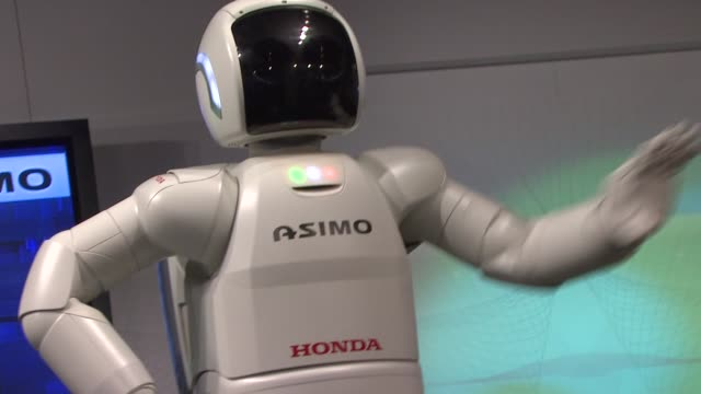 asimo at the the honda power of dreams experience at sundance film festival 2011 at park city ut - asimo stock videos & royalty-free footage