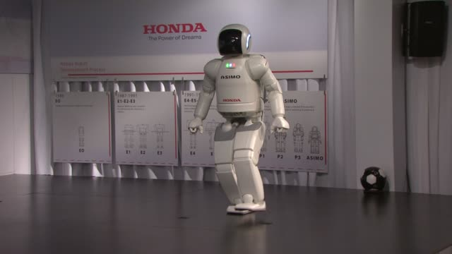 asimo at the the honda power of dreams experience at sundance film festival 2011 at park city ut - honda stock videos & royalty-free footage