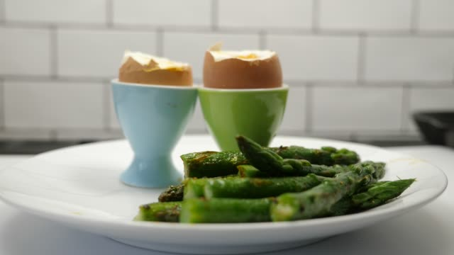 asparagus spear being dipped into an egg - hard boiled egg stock videos & royalty-free footage