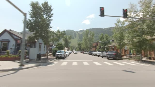 aspen 21 synced series right summer driving - street name sign stock videos & royalty-free footage