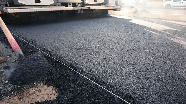 asphalt laying a new layer - tarmac stock videos & royalty-free footage