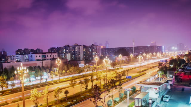 Asphalt road and modern skyline cityscape at night, Kunming China