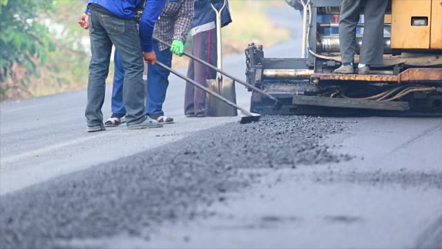 asphalt road construction - road construction stock videos and b-roll footage