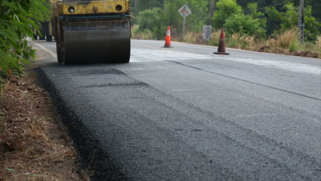 asphalt road construction - textile patch stock videos & royalty-free footage
