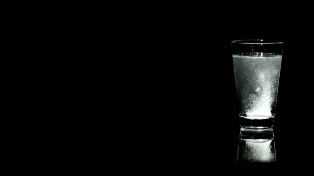 aspirin in a water glass - dissolving stock videos and b-roll footage
