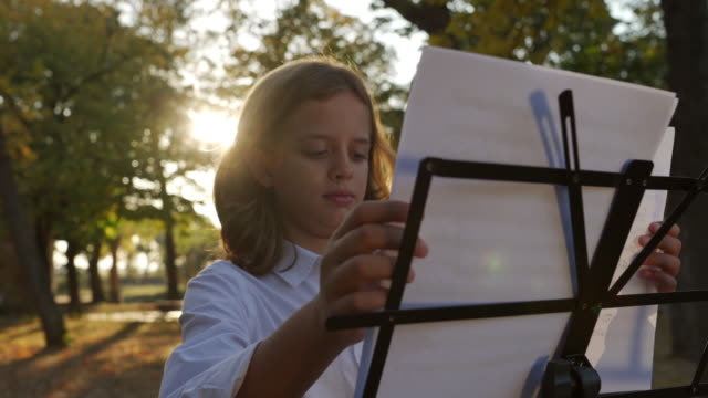 aspiring violinist placing sheet music in place - music stand stock videos & royalty-free footage